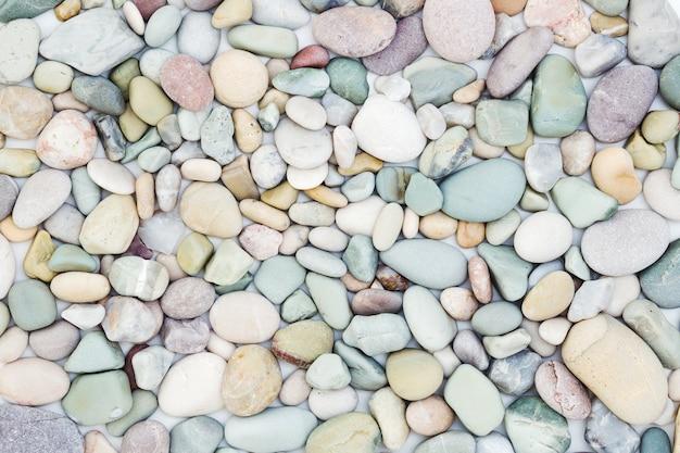 Sea pebbles texture, natural pastel colors background