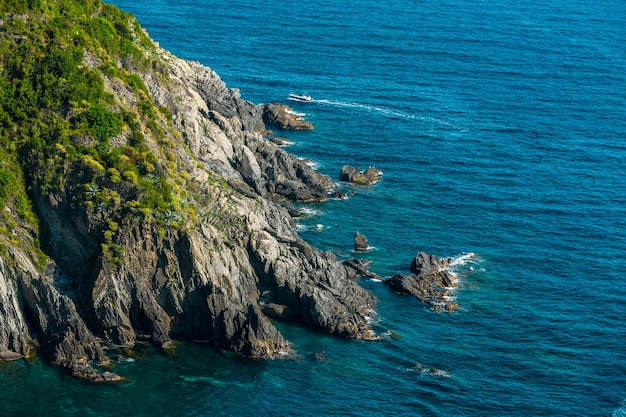 Sea and rocks in cinque terre national park in liguria, italy.