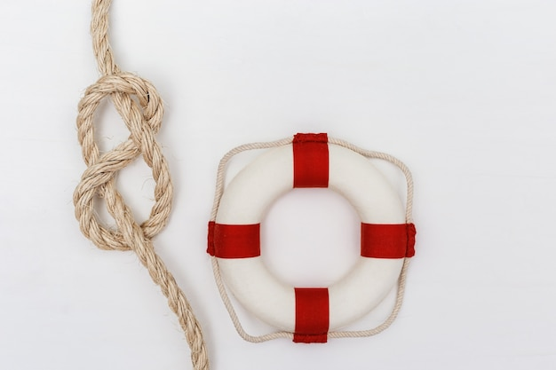Sea rope knot, lifebuoy on white