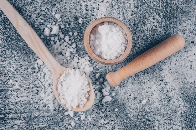 Sea salt in a bowl and spoon with rolling pin