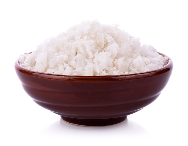 Sea salt in bowl on white background