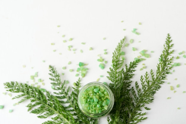 Sea salt with greenery on white background