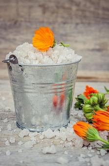 Sea salt with marigold extract. selective focus.