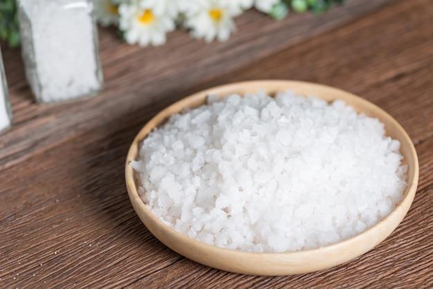 Sea salt in wood plate.