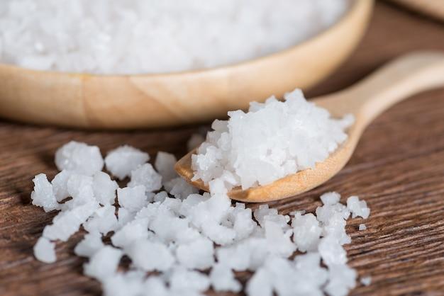 Sea salt in wood spoon.