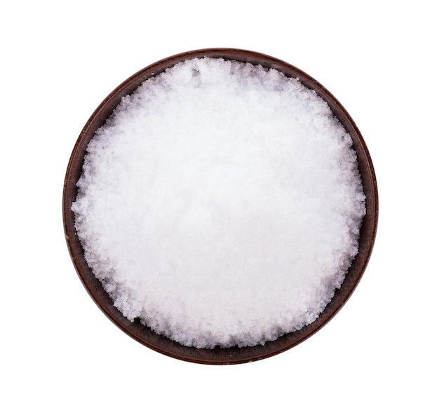 Sea salt on wooden bowl isolated on white surface