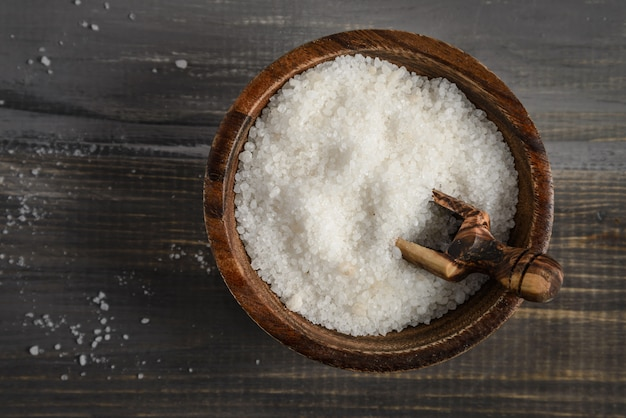 Sea salt in a wooden bowl with wooden spoon