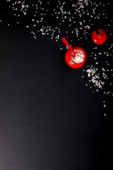 Sea salt in wooden red salt shaker