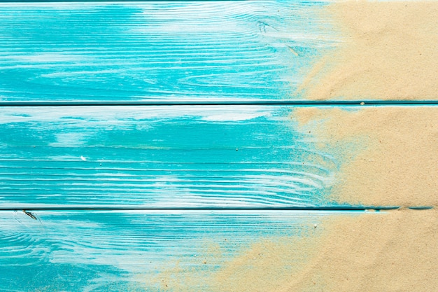 Sea sand on blue wooden floor,top view with copy space