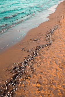바다 모래 하늘 개념 일몰 색상 구름 수평선 배경 배너 영감 자연 풍경 아름다운 색상 열대 해변의 멋진 풍경 해변 일몰 여름 휴가