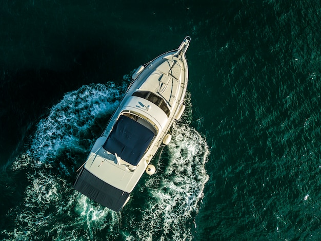 Sea service team in fast speed motor boat top overhead view