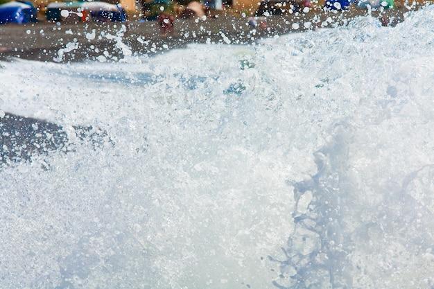 Sea surf wave closeup break on coastline