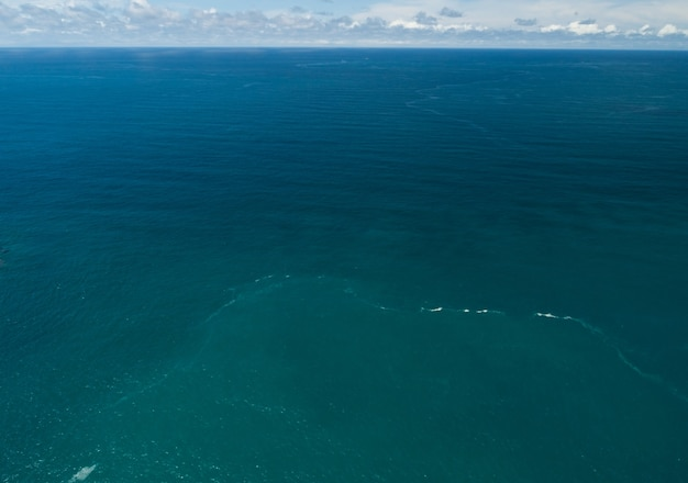 Sea surface aerial view,bird eye view photo of blue waves and water surface texture blue sea background beautiful nature amazing view.