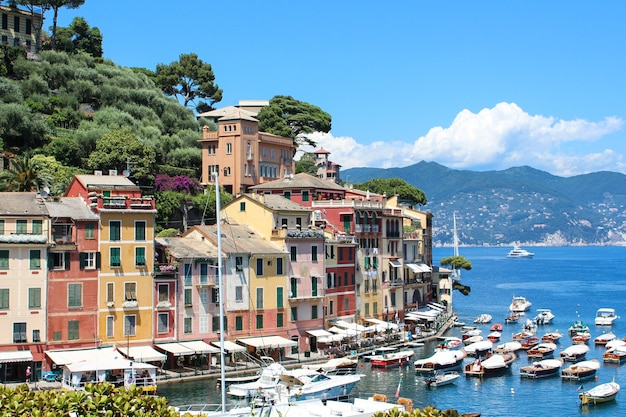 Sea view of beautiful italian city on liguria coast, hotels, restaurants, boats, people walking