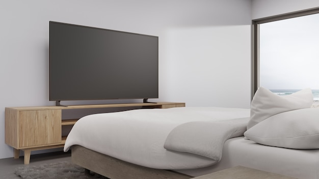 Спальня с видом на море роскошного летнего пляжного домика с телевизором на подставке под телевизор