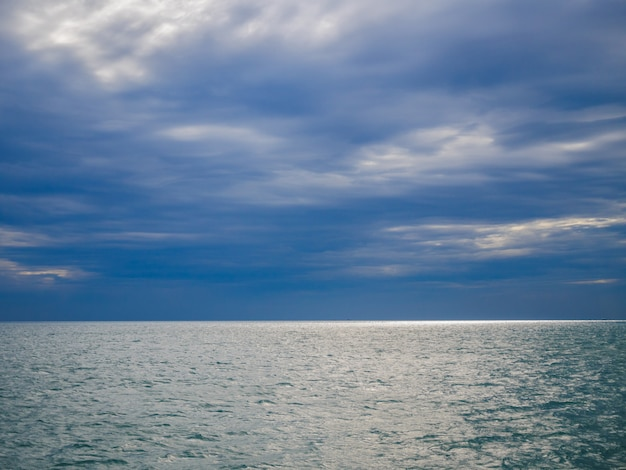 Sea view from gulf of thailand with the horizon and cloudy sky