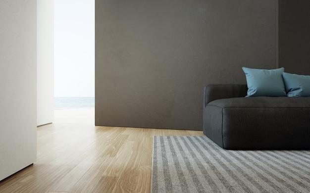 Гостиная с видом на море роскошного пляжного домика с диваном на деревянном полу. черная бетонная стена в доме отдыха или вилле.