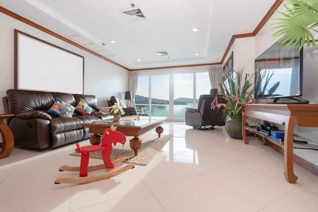 Sea view living room with wooden dining table