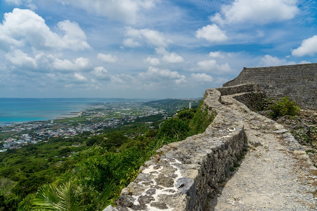 Sea view and stone wall at world heritage nakagusuku castle in okinawa, japan