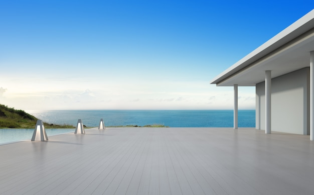 Sea view swimming pool and empty big terrace in modern luxury beach house