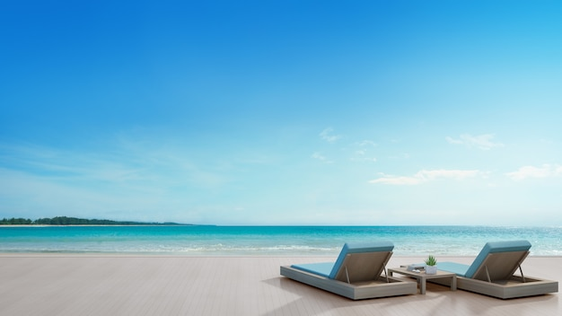 パノラマの景色を望むモダンで豪華なビーチハウスのシービューテラスとベッド