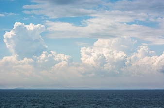 Sea view with sky and white clouds.