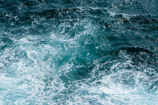 Sea water surface, dark blue ocean water for natural background