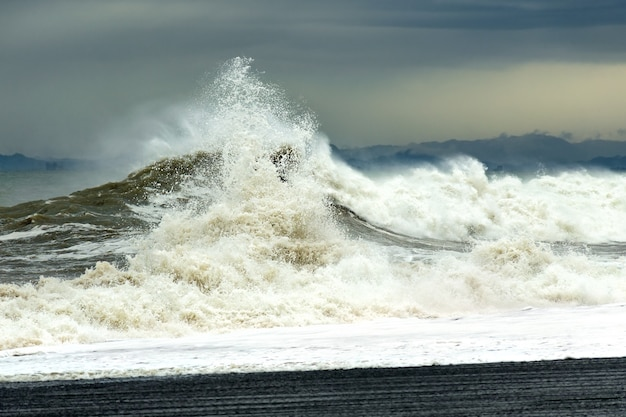 Sea wave with foam and spray during a storm.