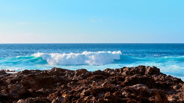 Sea waves on the coast of island.