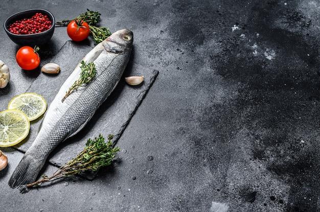 Seabass fish with herbs and lemon, raw sea bass.
