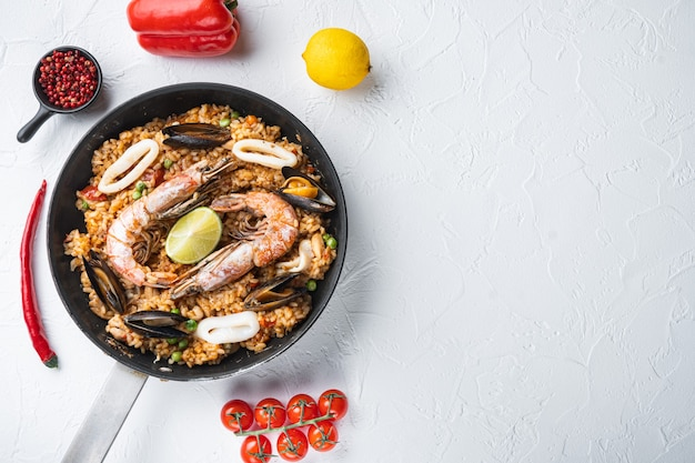 Seafood and chicken paella with rice in a pan