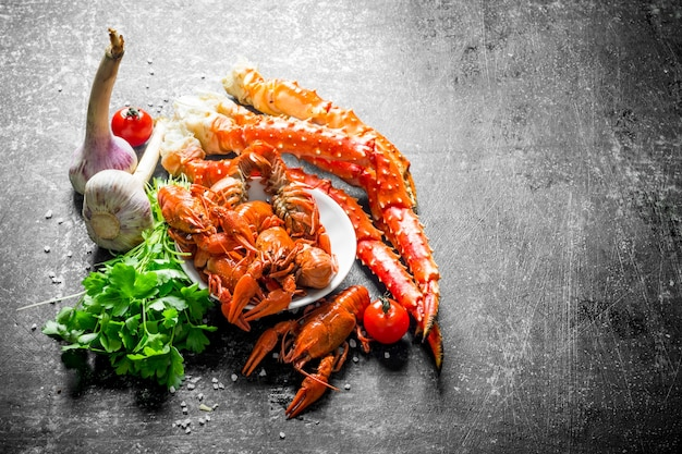 Seafood. cooked crayfish and crab with garlic, parsley and tomatoes.