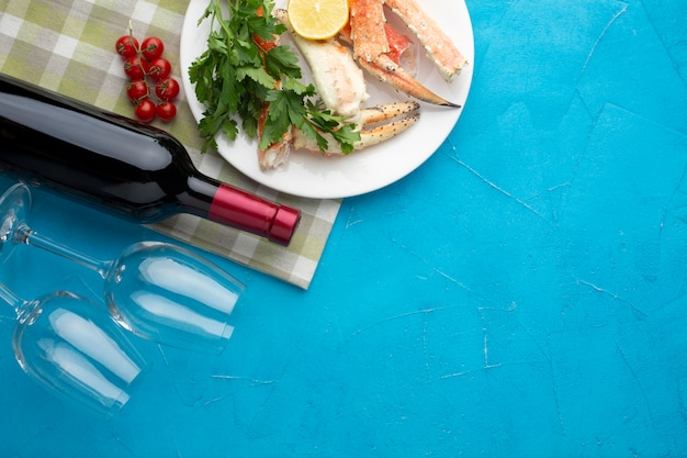 Seafood dish with wine bottle and glasses
