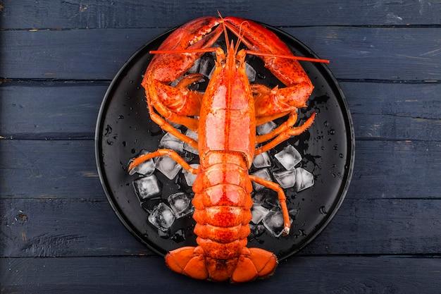 Seafood feast,lemon and fresh boston lobster on the ice
