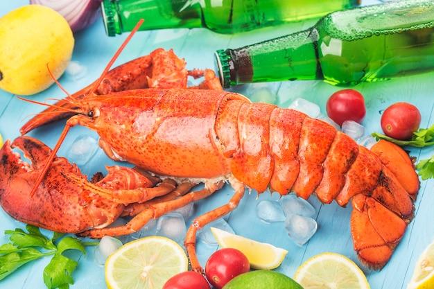 Seafood feastlemon and fresh boston lobster on the ice