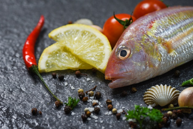 Seafood fish plate ocean gourmet dinner fresh raw fish with herbs and spices