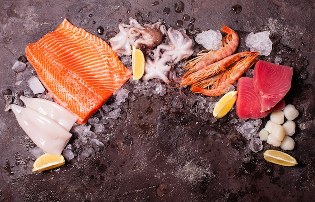 Seafood on the ice, border top view with empty space for text
