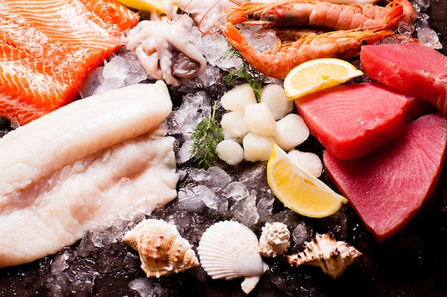 Seafood on the ice, top view on the brown stone background