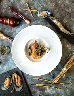 Seafood mussels salad with galetta in white plate.