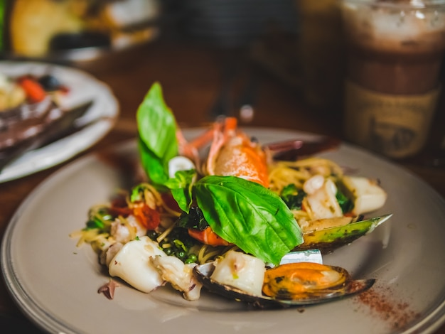 Seafood pasta spaghetti delicious with clams, prawns, sea scallops spicy.