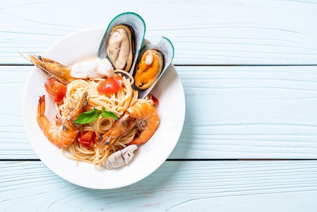 Seafood pasta spaghetti with clams, prawns, squis, mussel and tomatoes