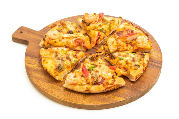 Seafood pizza on wood tray isolated on white surface