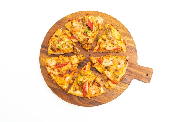 Seafood pizza on wood tray isolated