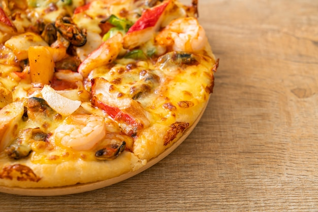 Seafood pizza on wood tray