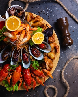 Seafood plate with shrimps, mussels, lobsters served with lemon