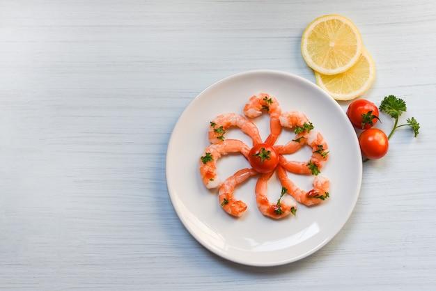 Seafood plate with shrimps prawns ocean gourmet dinner served