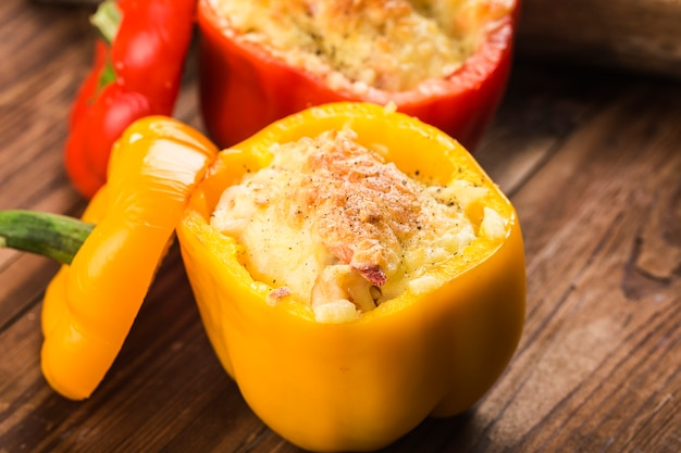 Seafood rice with cheese, stuffed peppers with rice and minced meat. .grilled green pepper with cheese