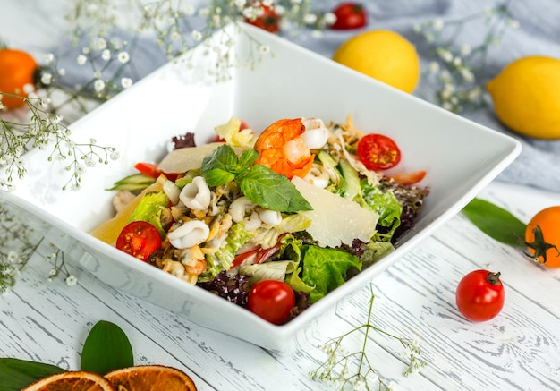 Seafood salad with herbs and tomatoes