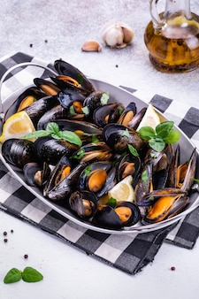 Seafood shell mussels with lemonnd basil.