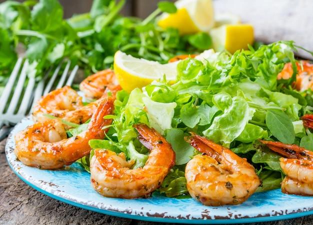 Seafood shrimp lettuce salad on blue plate